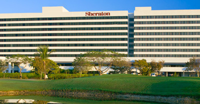 Exterior view of the sheraton miami airport, mia parking.